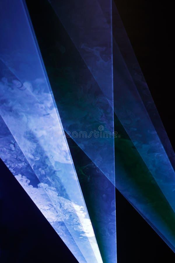 Laserlichte und Rauch stockbild