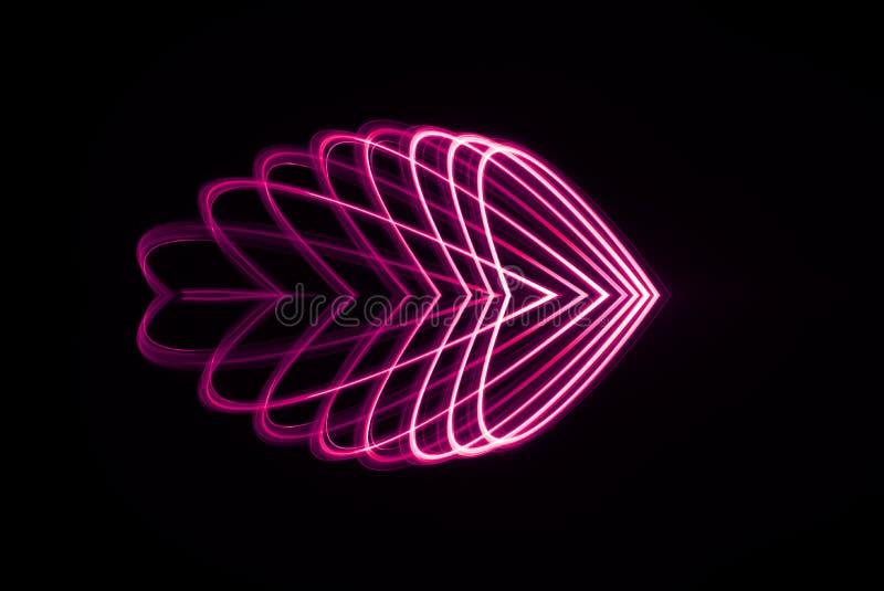 Laserowy spirograf wewnątrz w czerwieni i menchii świetle rozszerzającym w różnorodnych kierowych kształtach obrazy royalty free