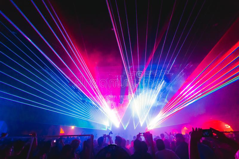 Lasers at a rave, party, club. Bright blue, purple, and red colors royalty free stock photos