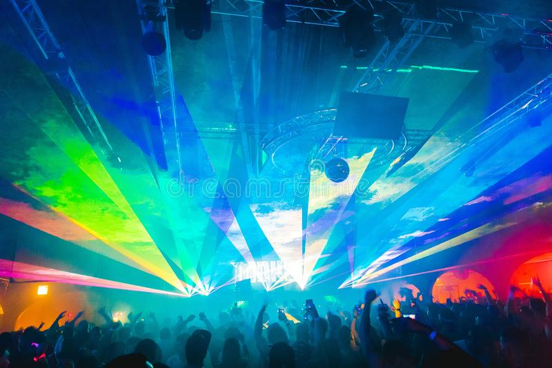 Lasers at a rave, party, club. Bright blue, purple, and red colors royalty free stock photography