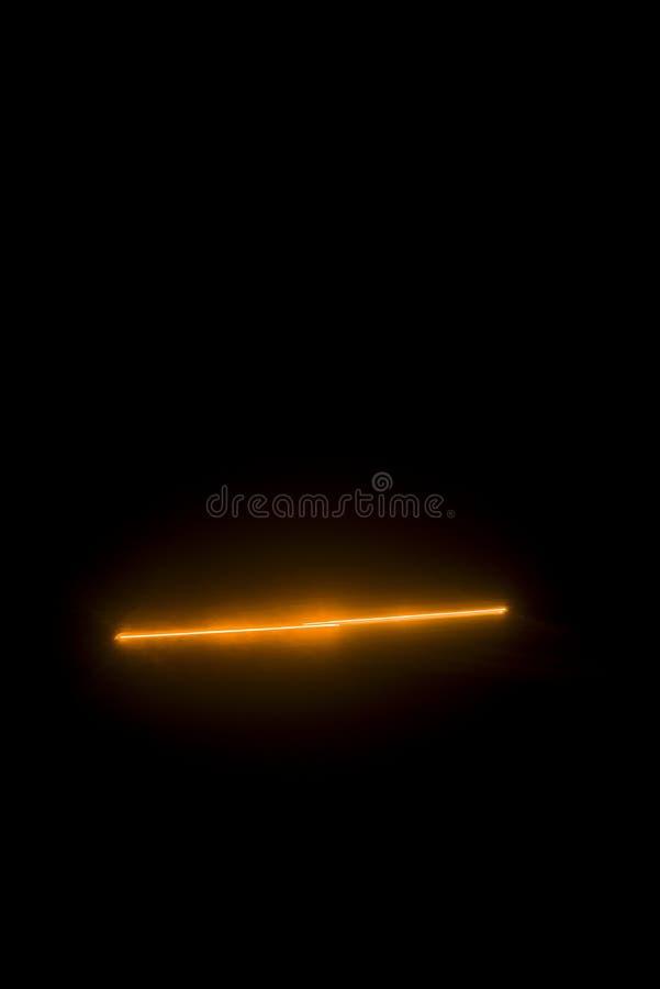 Laserstrahlorange stockfotografie