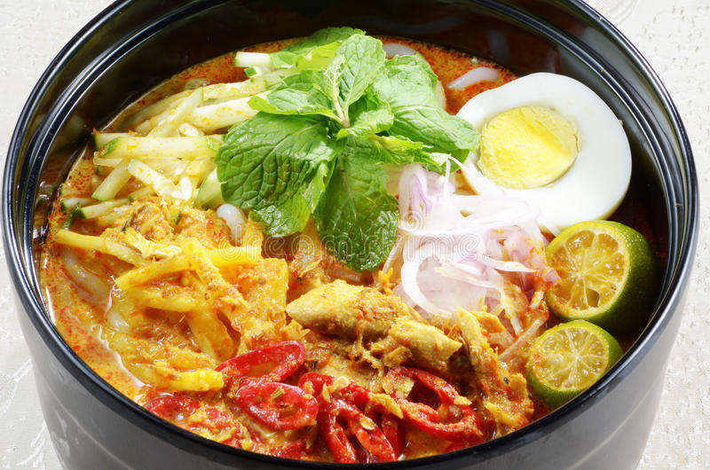 Laska. Spicy noodle soup in the Peranakan cuisine, which is a combination of Chinese and Malay cuisine royalty free stock photos