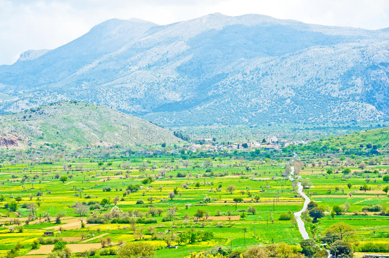 Lassithi Plateau , Crete. An image of the Lassithi Plateau in Crete which despite being high up in the mountains is a productive agricultural area and popular stock image