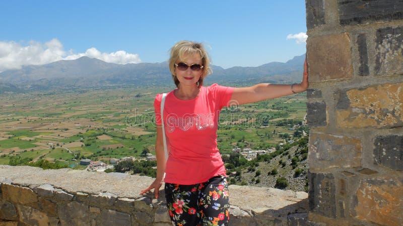 Lassithi Plateau. A woman sits amid Lassithi Plateau, near the Cave of Zeus. Greece. Crete stock images