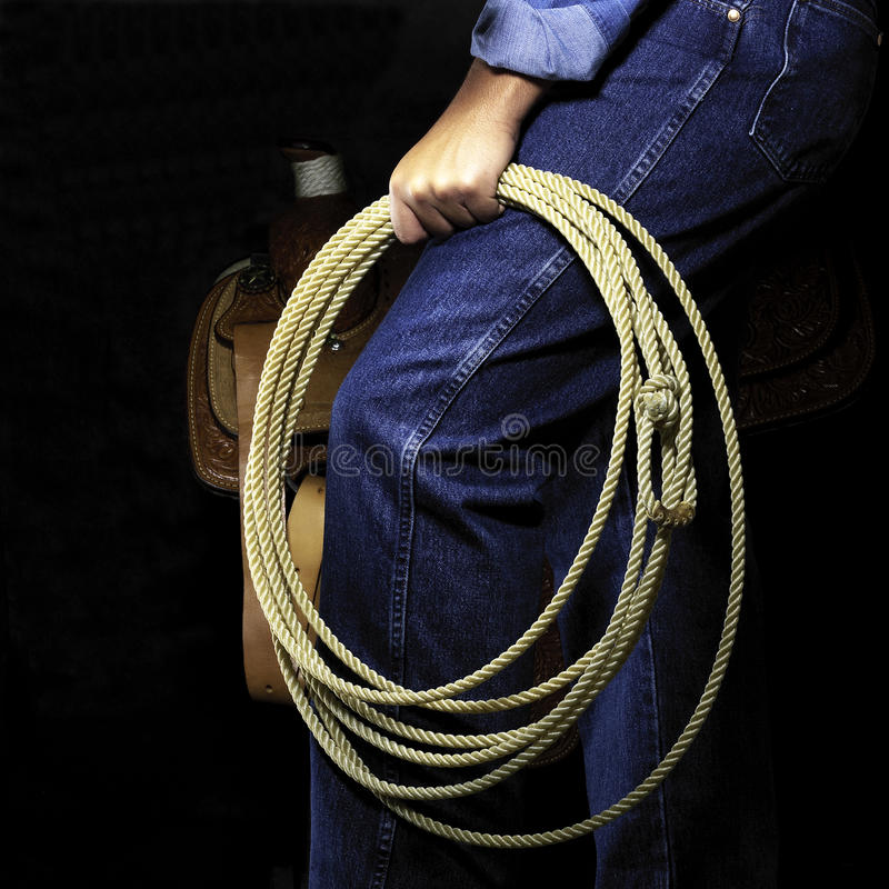 Lasso rope. Cowboy holding a lasso rope stock photo