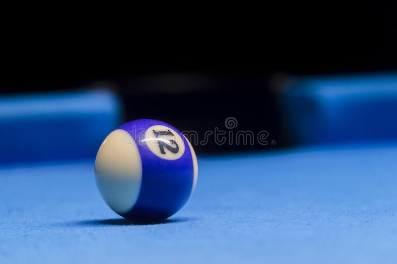 The last ball on the billiards table. The last blue ball on the billiards table stock photo