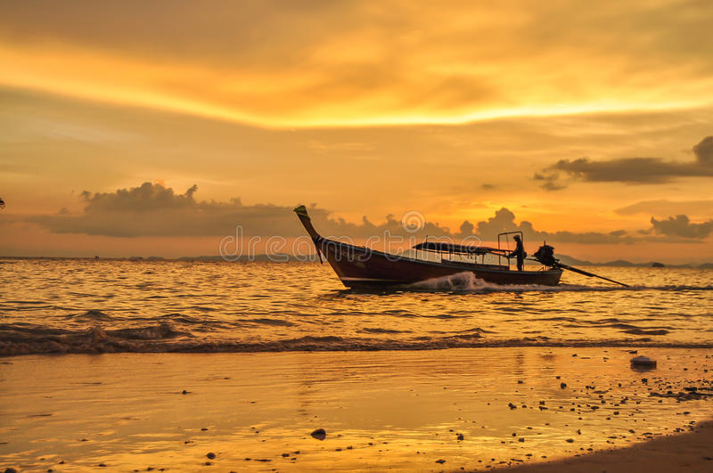 Last boat arriving to Railay stock images