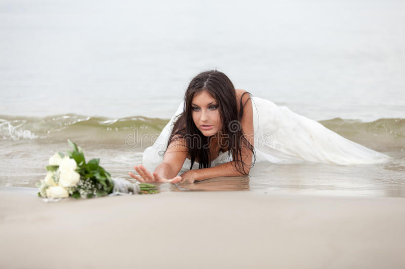 Last change to get married. Abandoned bride is trying to reach bridal bouquet royalty free stock photos