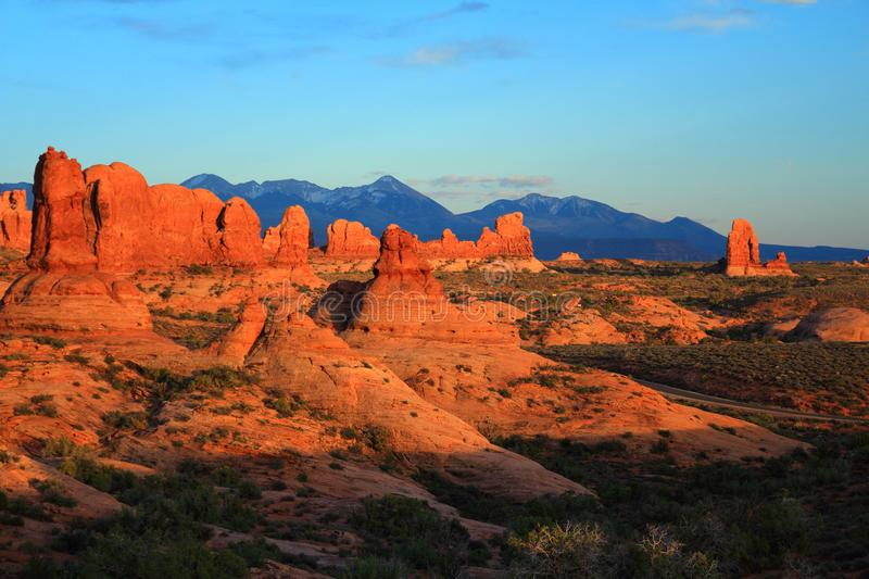 Garden of Eden in Evening Light, Arches National Park, Utah. Last evening light shining on the sandstone sculptures at the Garden of Eden with the snowy La Sal stock photography