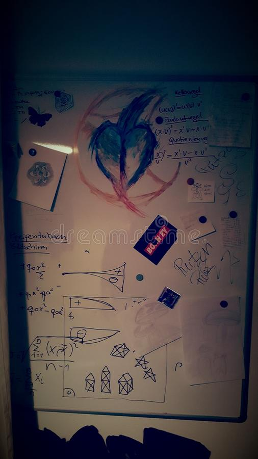 Last few months. Whiteboard with stuff that represents a few months of stydying and other important thinks. Cleaned it after taking a picture stock image