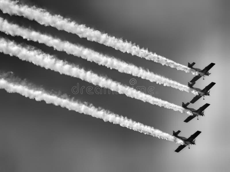 Last flight of four piston propeller aerobatic aicraft. royalty free stock images
