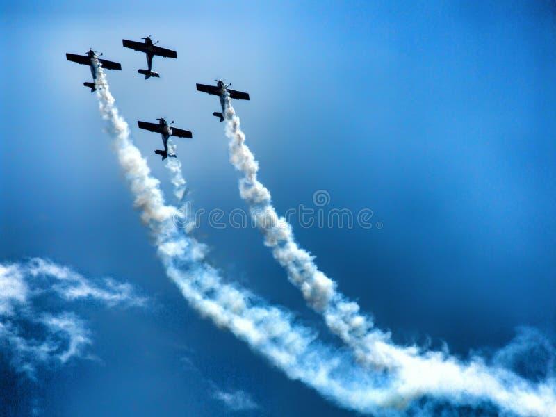 Last flight of four piston propeller aerobatic aicraft. stock photo