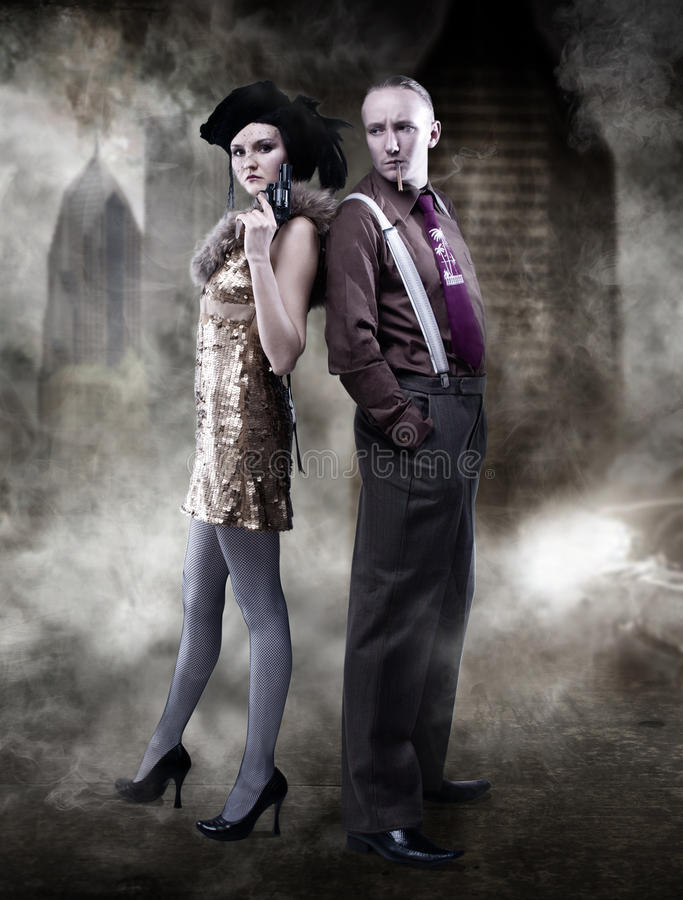Last gangsters in Chicago. Attractive young couple royalty free stock photo