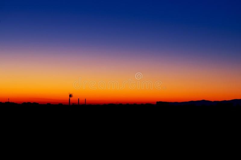 Last hope for Hope. Sunset view with beautiful colors and contrasting urban landscape royalty free stock photo