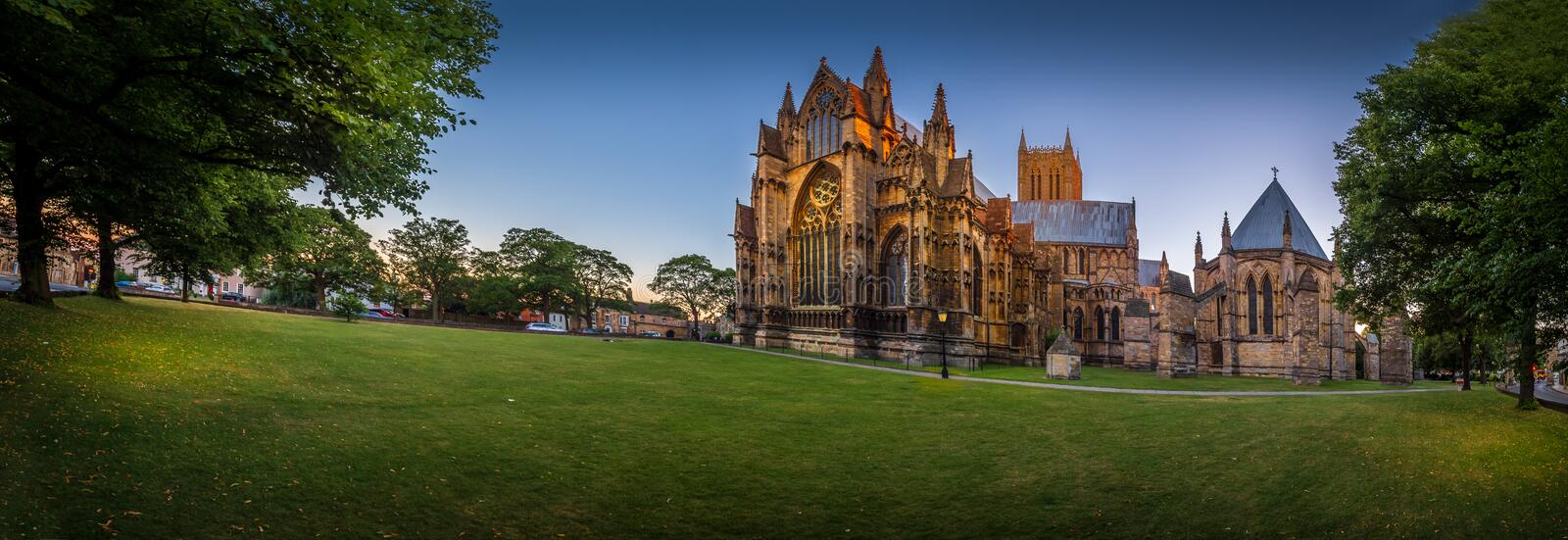 Last light over Lincoln Cathedral. Extra wide angle shot of Lincoln Cathedral and Green, Lincoln, Lincolnshire, United Kingdom stock photo