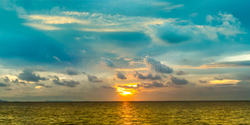 Last light of panorama sunset on horizon line over sea. In the evening twilight time stock images