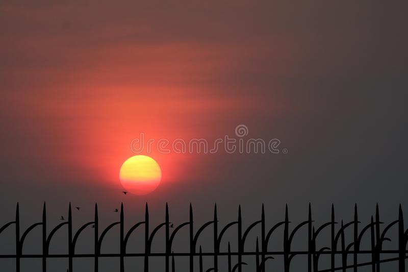 last light of sunset back silhouette metal fence royalty free stock images