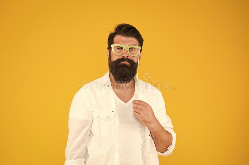 Last minute costume party ideas. Bearded man happy to join party. Guy with beard and mustache hold eyeglasses photo royalty free stock images