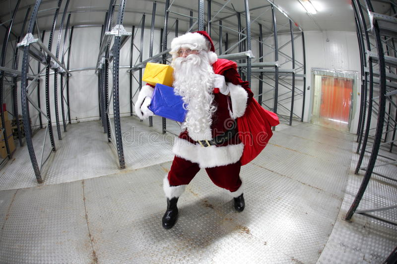 Download Last Minute Santa Claus Leaving Empty Storehouse Royalty Free Stock Image - Image: 27804316