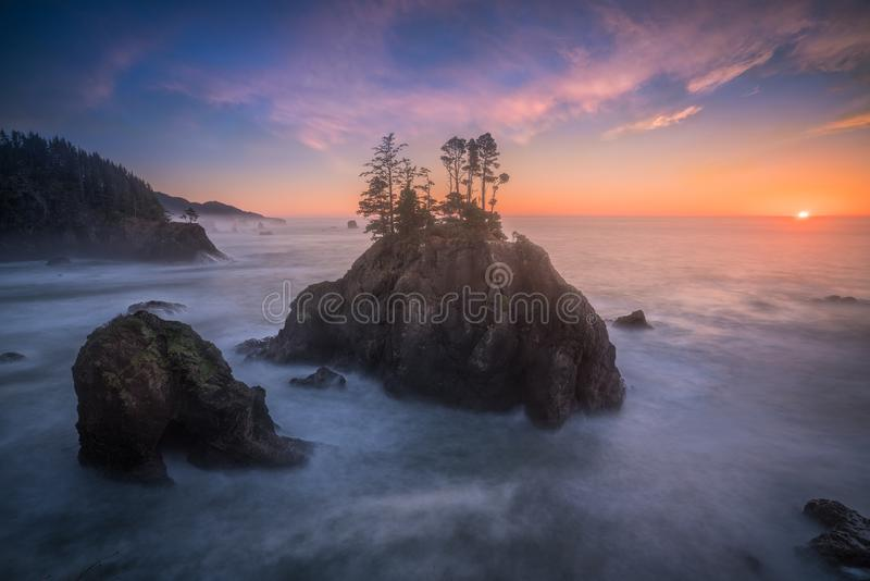 The last minute sunset and soft ocean of Oregon coast. This is a wide angle shot of the last minute of sunset and soft ocean view at Oregon coast stock images