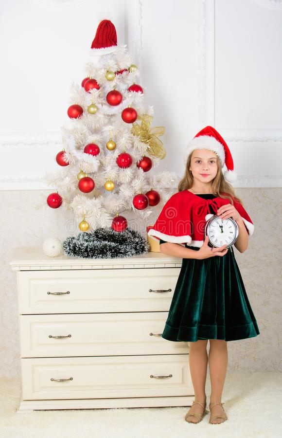 Last minute till midnight. Last minute new years eve plan. Merry christmas concept. New year countdown. Girl kid santa royalty free stock photos