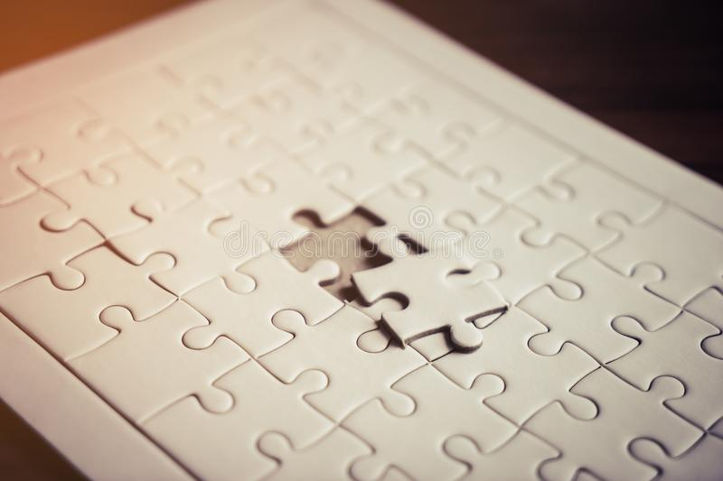 Last piece of jigsaw is almost in place for business solution concept royalty free stock photos