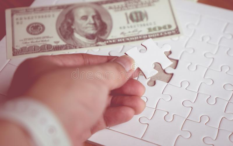 Last piece of jigsaw put in place for financial concept stock image