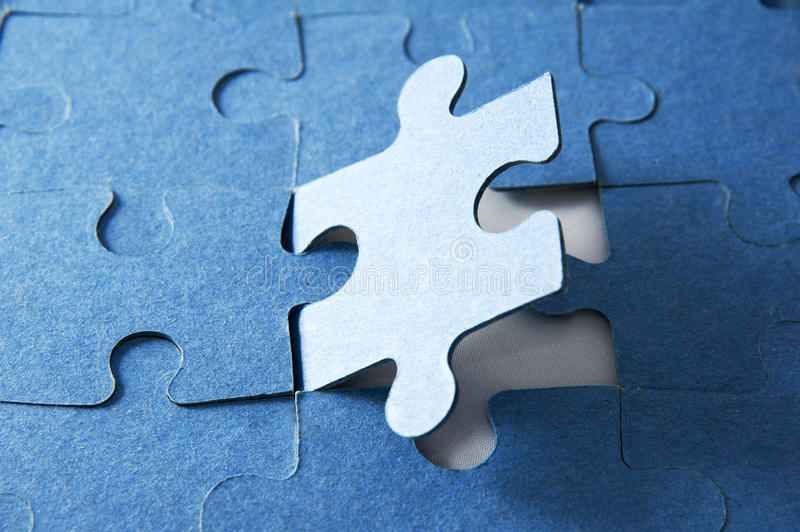 Last piece of jigsaw puzzle. Blue tone royalty free stock photos
