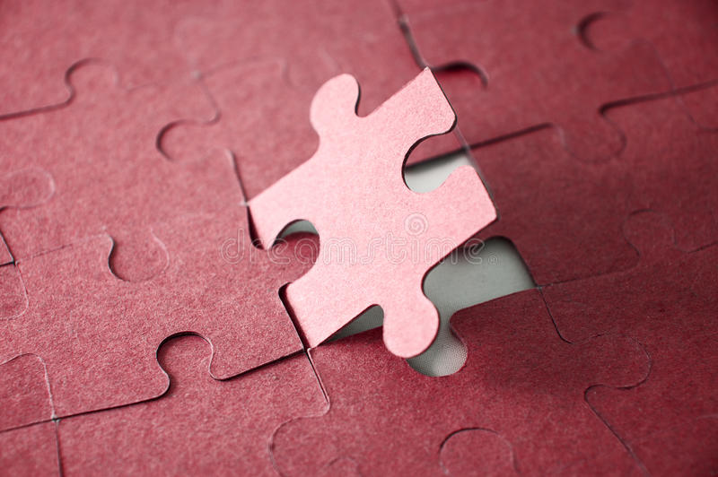 Last piece of jigsaw puzzle. Red tone royalty free stock photo