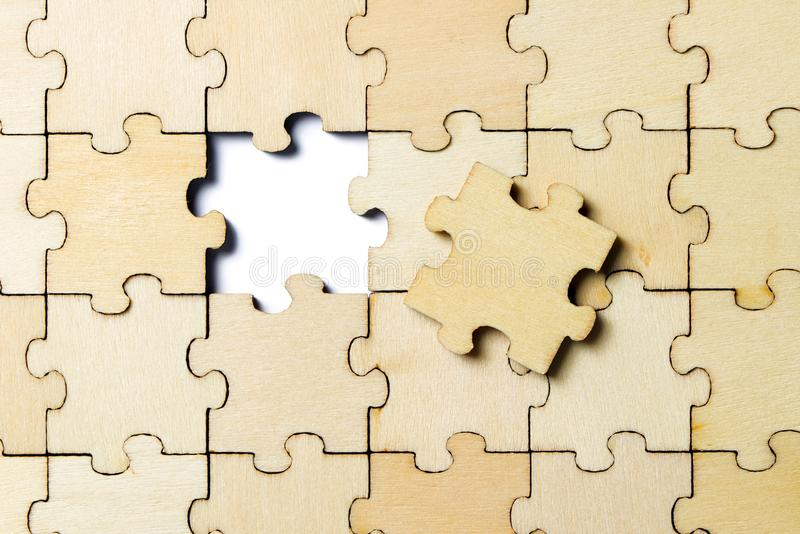 The last piece of a jigsaw wooden puzzle stock photography