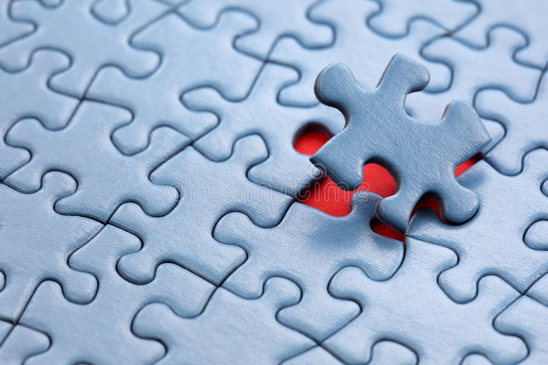 Last piece of the puzzle. The last piece of jigsaw puzzle concept for solution and completion royalty free stock images