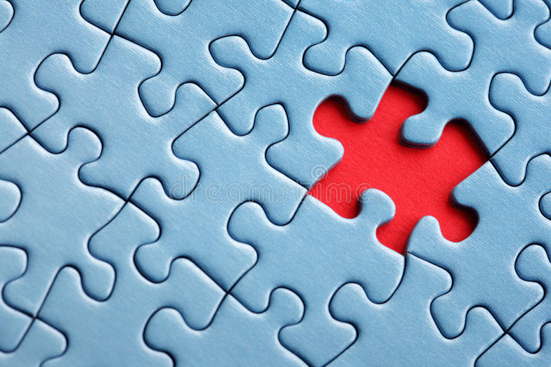 Last piece of the puzzle. The last missing piece of jigsaw puzzle concept for solution and completion stock image