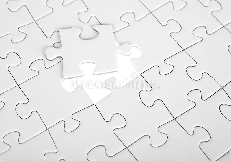 Last piece of white puzzle royalty free stock photos