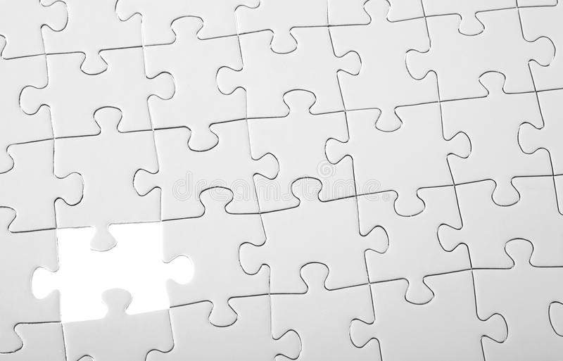 Last piece of white puzzle royalty free stock image