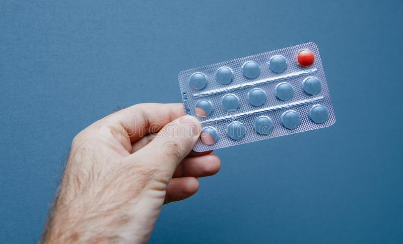 Last pill medical healthy hope treatment in male hand stock images