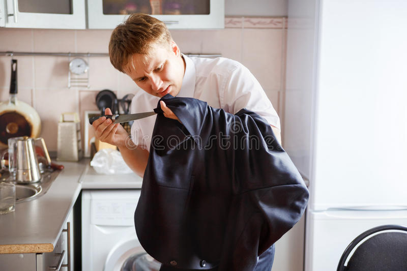 Last preparations of groom, all at the last minute. Last preparations of the groom, all at the last minute.He ripped a kitchen knife pockets sewn in the new stock images