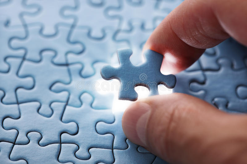 Last puzzle piece. The last piece of jigsaw puzzle concept for solutions and completion royalty free stock images