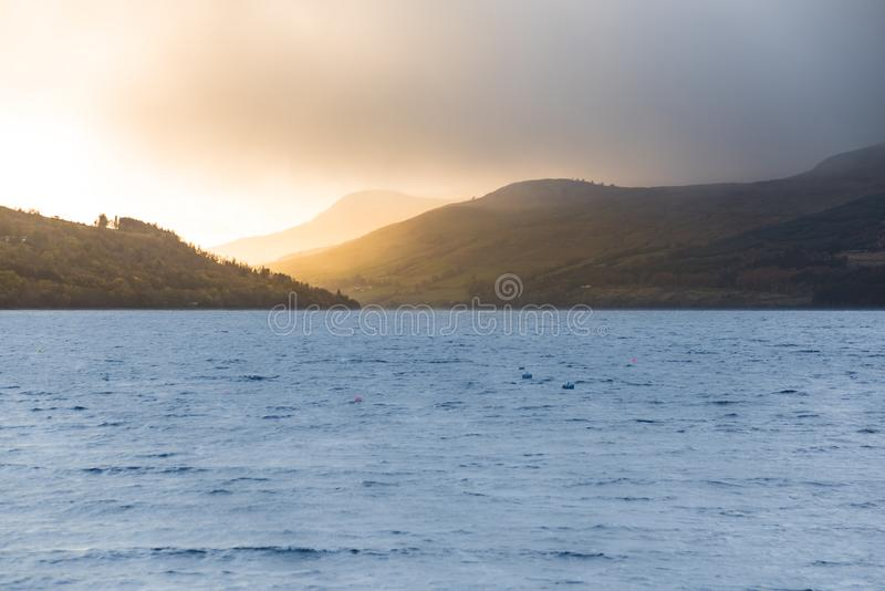 Last rays of sun over Ben Lawers - view from the banks of Loch Tay royalty free stock photo