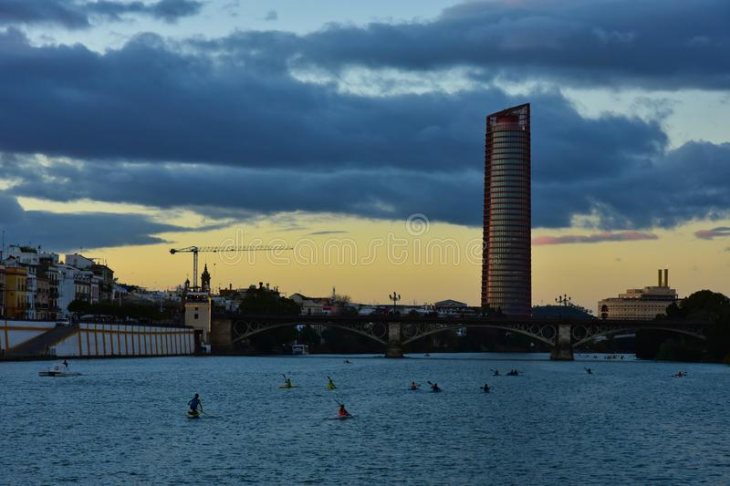 Sunset on the Guadalquivir river in Seville, Spain. The last rays of sun on the river of the Andalusian capital stock image