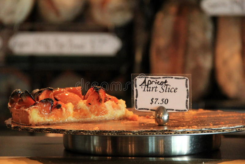 Last slice of Apricot tart on display at bakery stock photos
