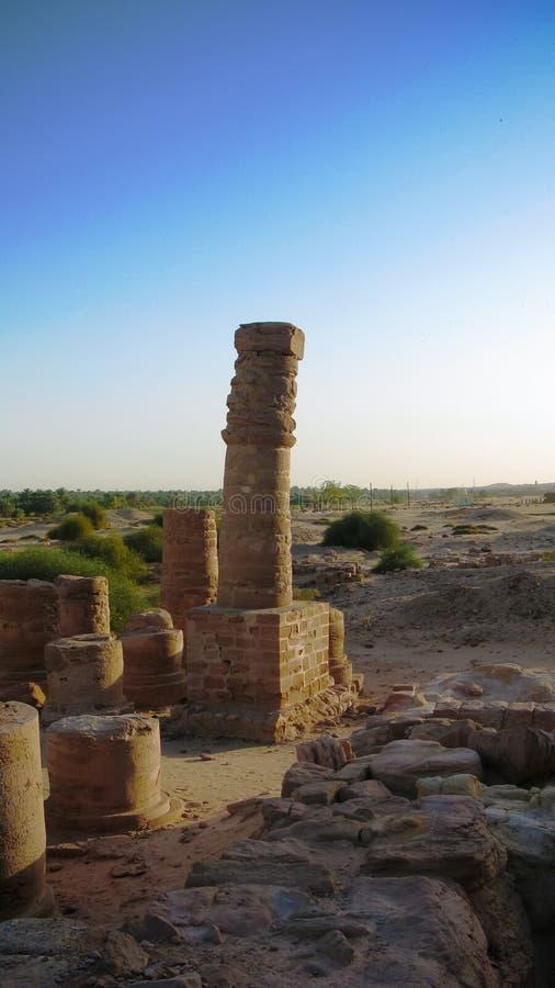 Last standing pillars of Napata`s temple of Amun at the foot of Jebel Barkal mountain , Karima, Sudan. Last standing pillars of Napata`s temple of Amun at the royalty free stock image