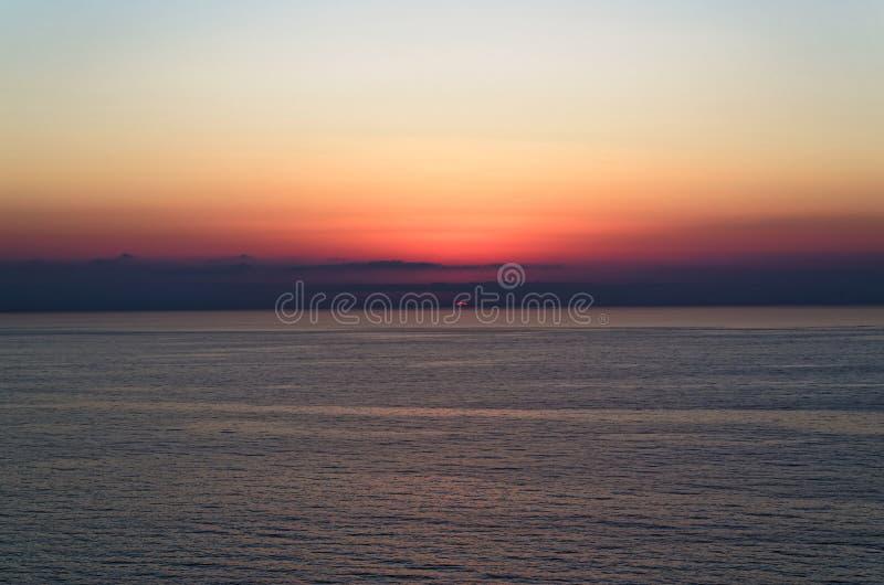 Last sun rays above tyrrhenian sea - sunset. On the Riaci beach near Tropea, Italy stock photos
