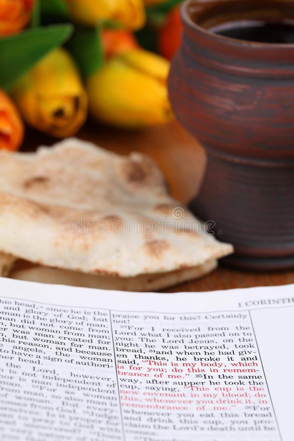 Last supper. Bible open to 1 Corinthians 11 with selective focus on the text about the Last Supper. Shallow dof stock photography