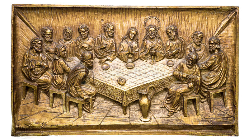 The Last Supper. Carving on ceramic and colored with gold. Isolated on white background royalty free stock photography