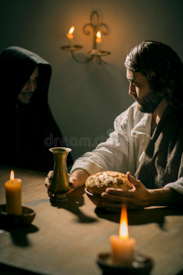 The Last Supper of Jesus Christ. Jesus Christ watching the devil during the last supper royalty free stock photo