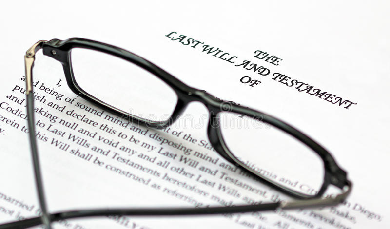 Last Will. A last will and testament document and a pair of reading glasses royalty free stock images