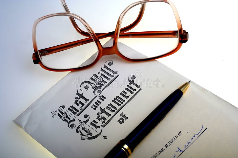 Last Will & Testament. Last will and testament document with eyeglasses and pen royalty free stock photography