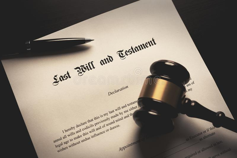 Last Will and Testament concept. Close up of fountain and gavel on desk royalty free stock image