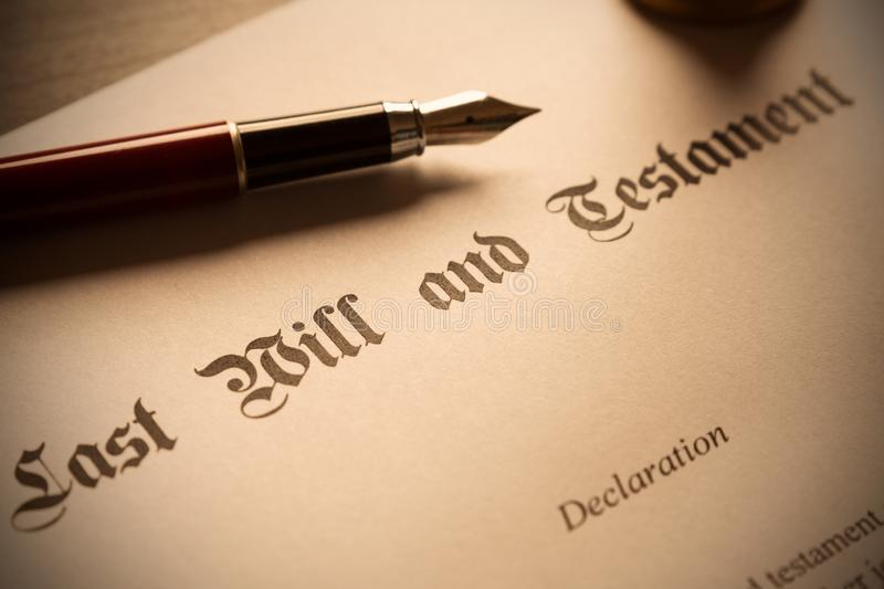 Last Will and Testament concept. Close up of fountain pen on desk royalty free stock photo