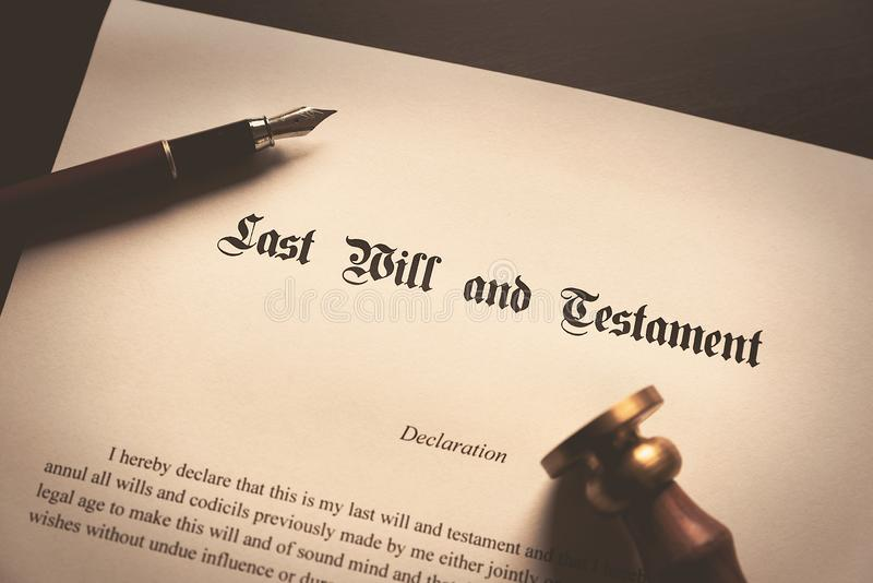 Last Will and Testament concept. Fountain pen, seal on desk royalty free stock images